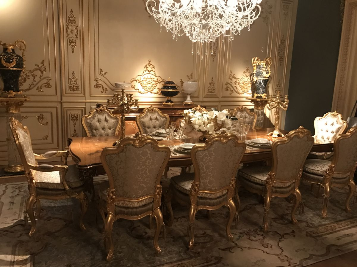 An abundance of gilded detailing is characteristic of a Baroque dining room.