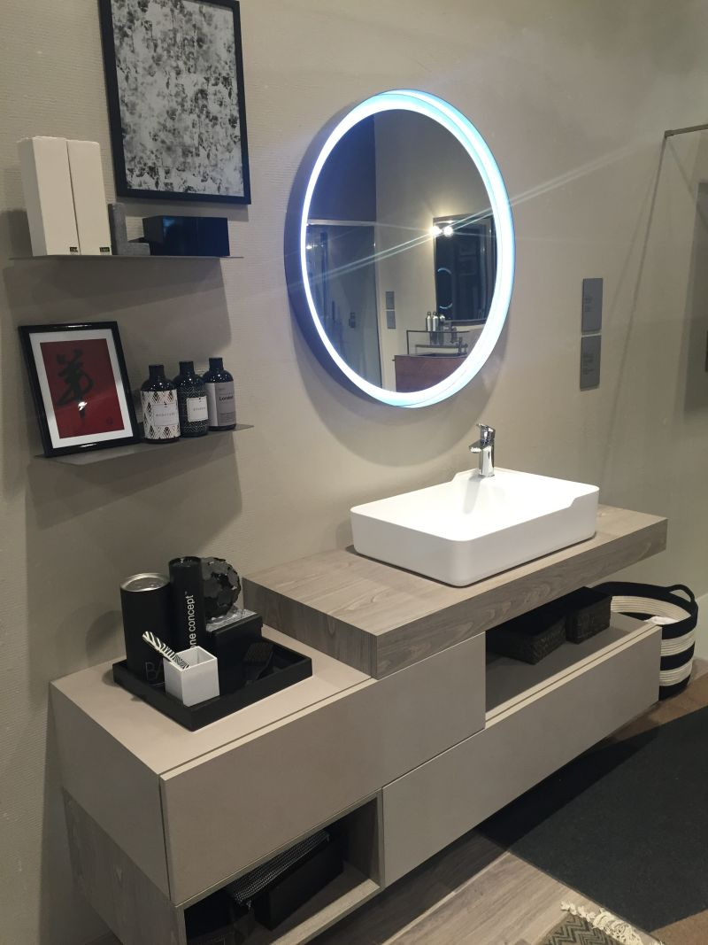 Round led mirror and shelves for storage in bathroom