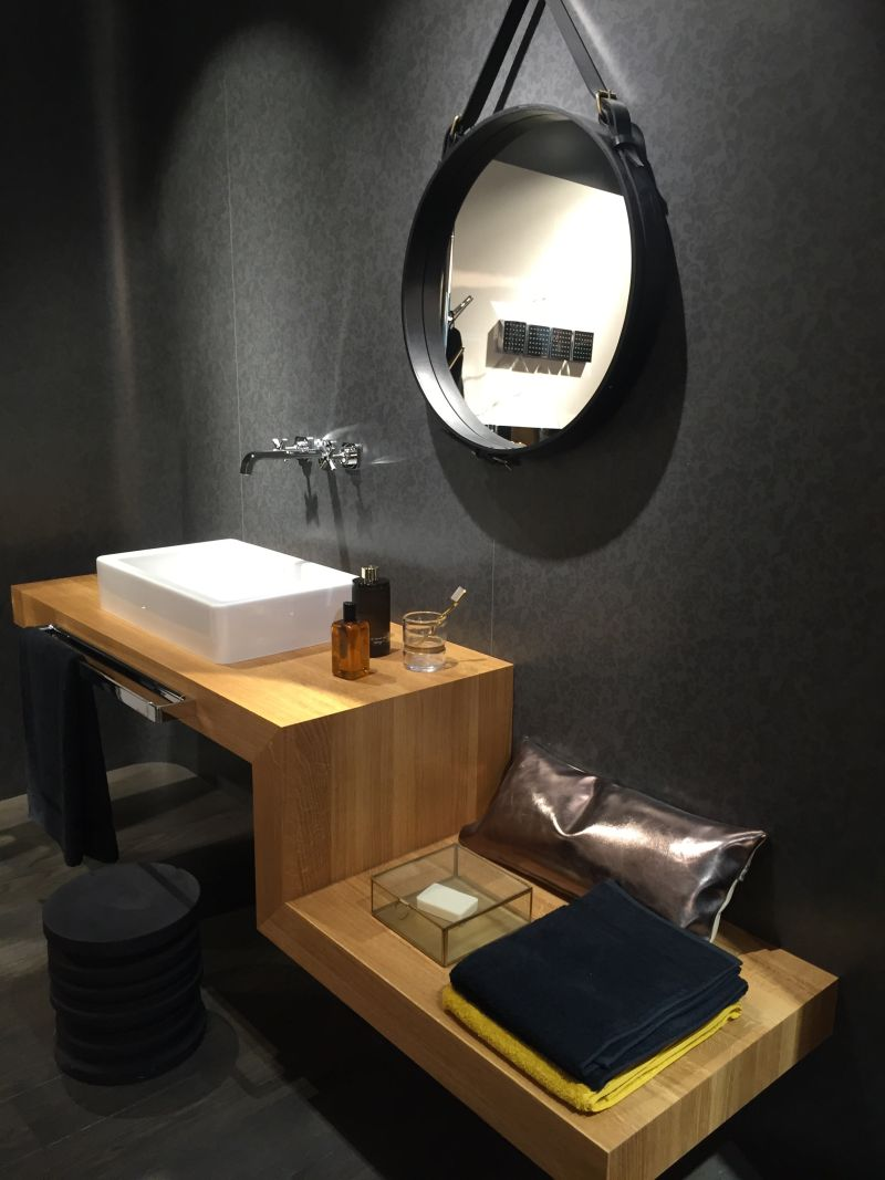 Round mirror and z shaped furniture for bathroom