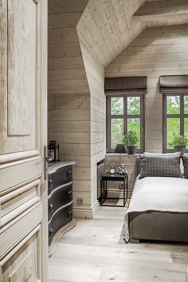 Wood-paneled walls and angled ceilings give the bedrooms a very inviting and relaxing look