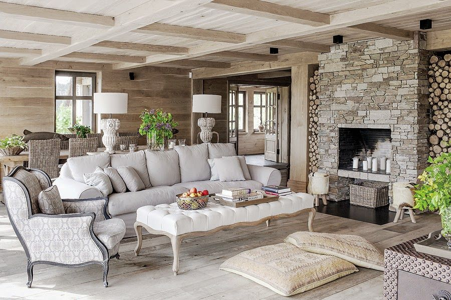 The living room is at the center of the open plan social area and is highly focused on warmth and comfort