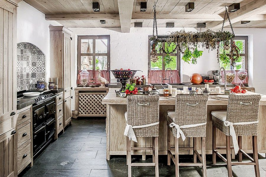 The kitchen island doubles as a breakfast bar and has a gorgeous chandelier hanging above it