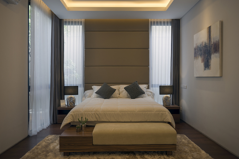 The bedroom is small but doesn't lack natural or artificial lighting and it feels really cozy and inviting