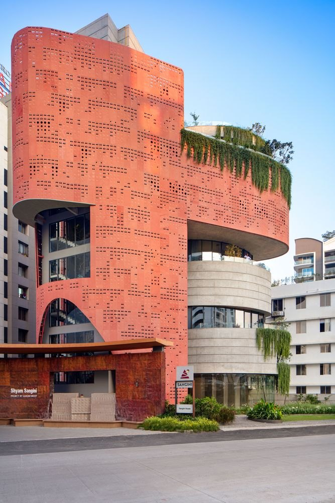 The red terracotta-like color gives the building lots of visual appeal and character