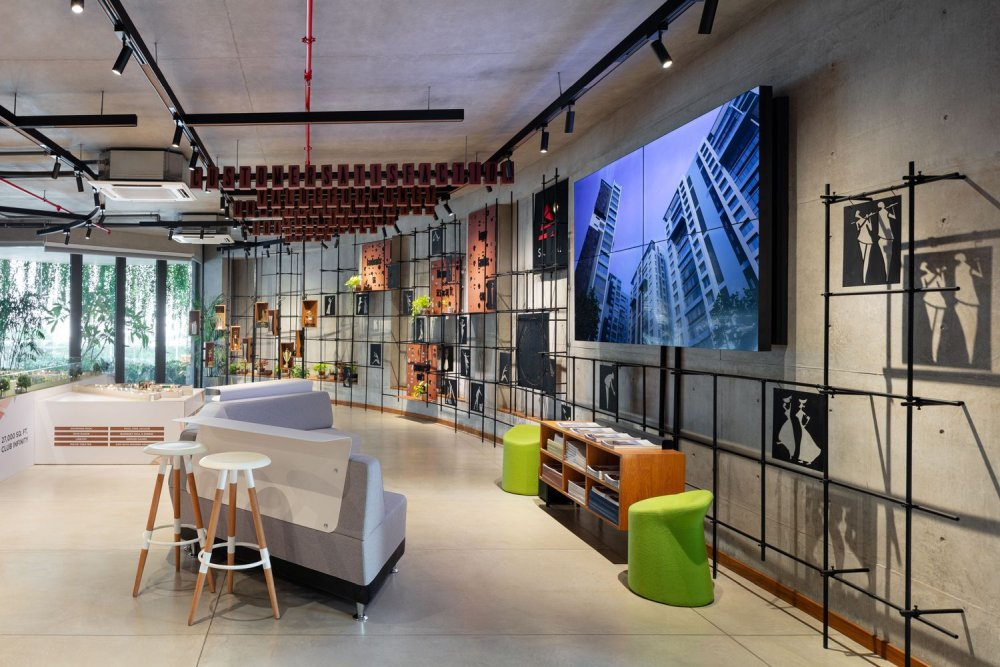 The exposed concrete walls and ceilings give the interior a strong industrial character