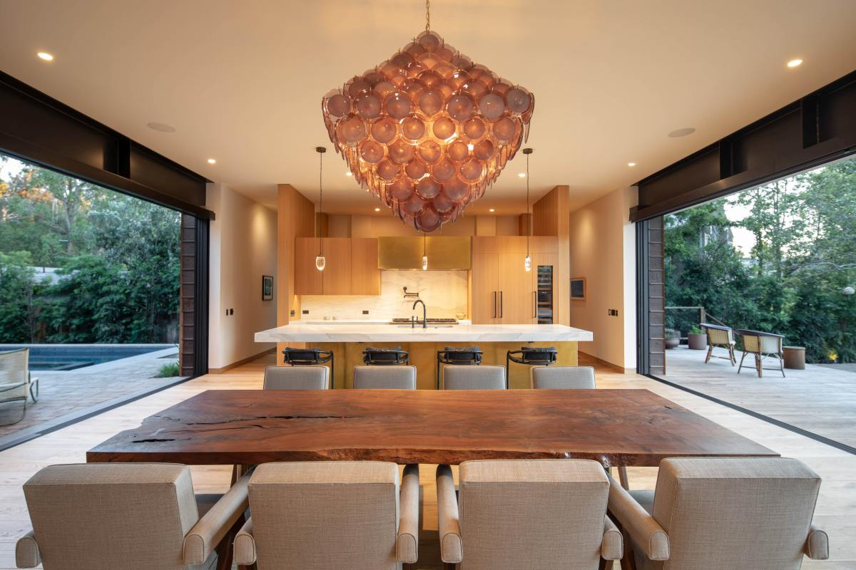 The kitchen and dining area have similar styles based on warm and simple colors