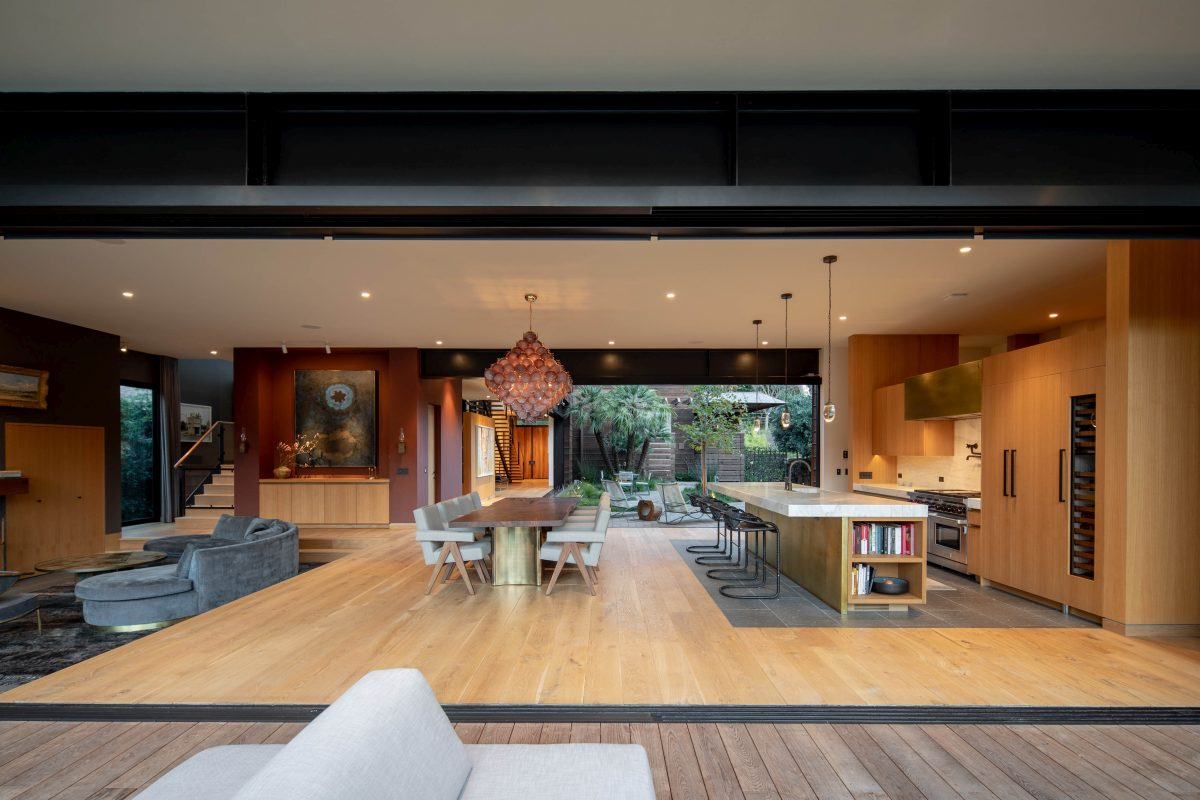 The social area is a big open space with sliding walls that open onto a deck