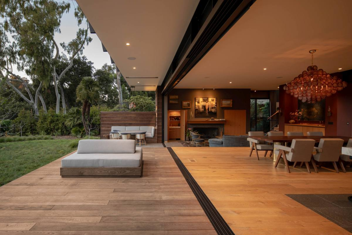The transition from inside to the outdoor areas is seamless and that helps to connect the house to its surroundings