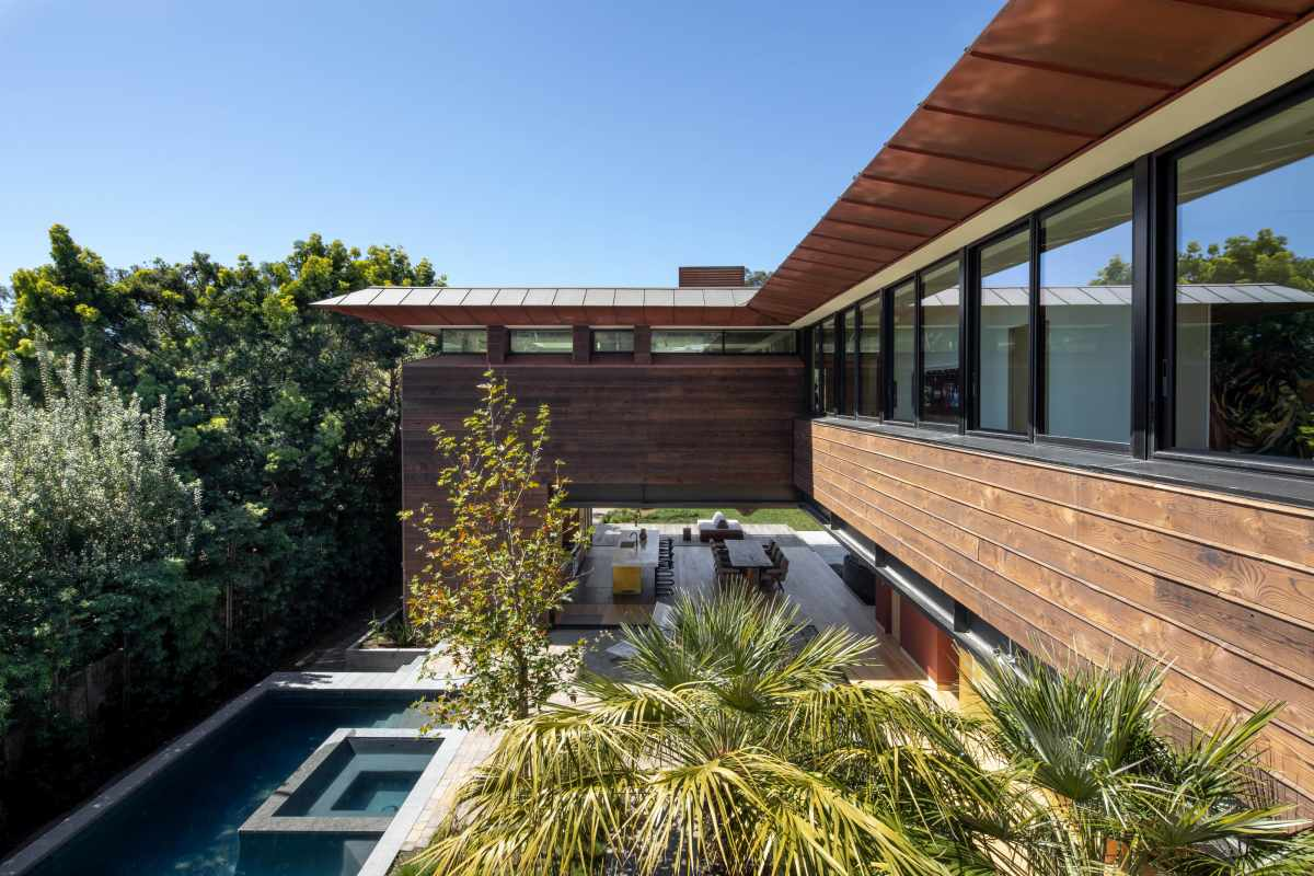 The house is surrounded by lots of trees that form a natural barrier, a privacy shield around it