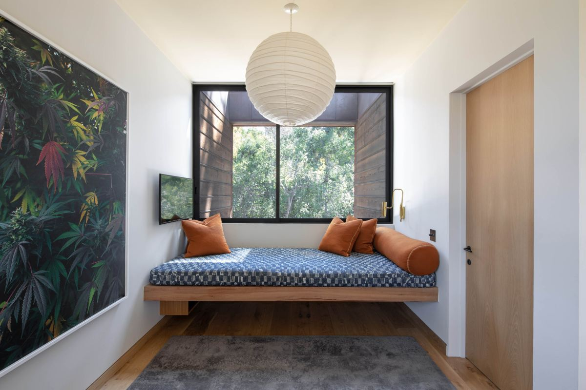 A cozy seating and reading nook was created in front of this window