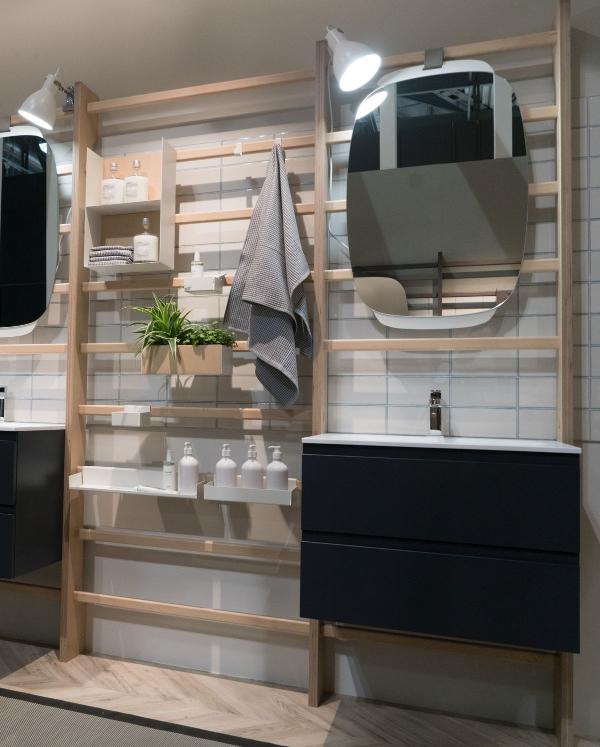 Various different accessories such as light fixtures, storage shelves, towel racks and mirrors can be mixed and matched as desired