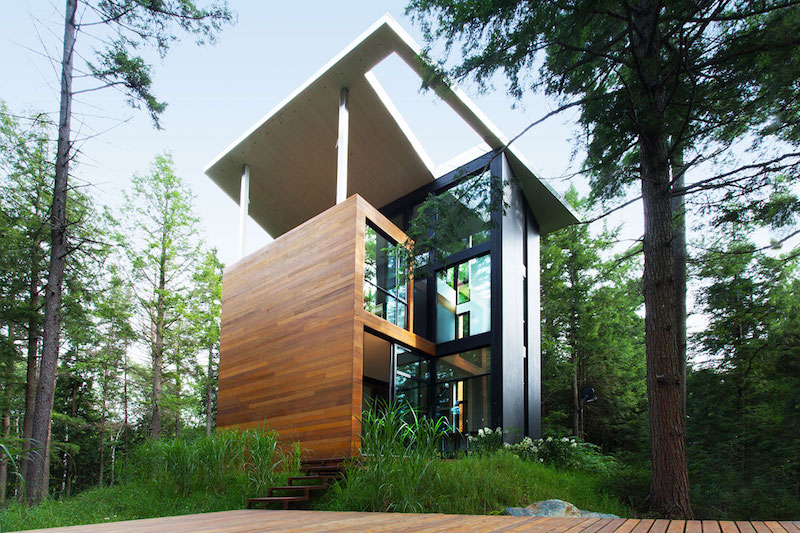Sculptural tower house covered deck