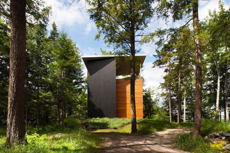 Sculptural tower house surronded by trees