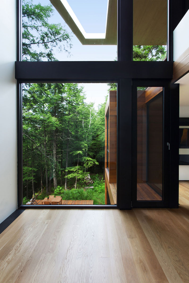 Sculptural tower house view of forest