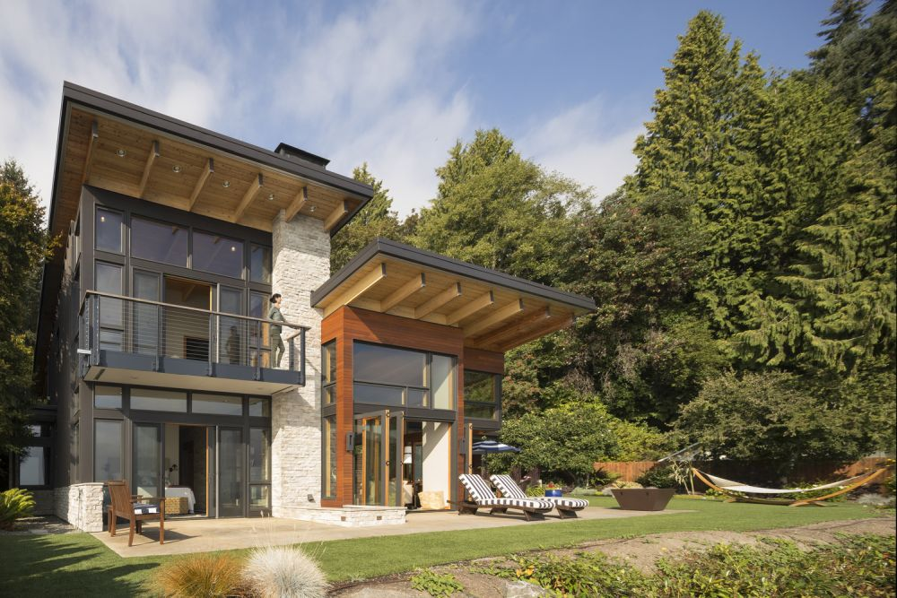 This modern family retreat occupies the same footprint as the old house and cabin used to