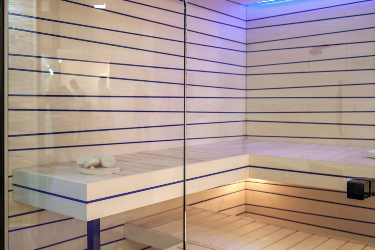 The wood detailing in the seats and walls is particularly interesting in this sauna room