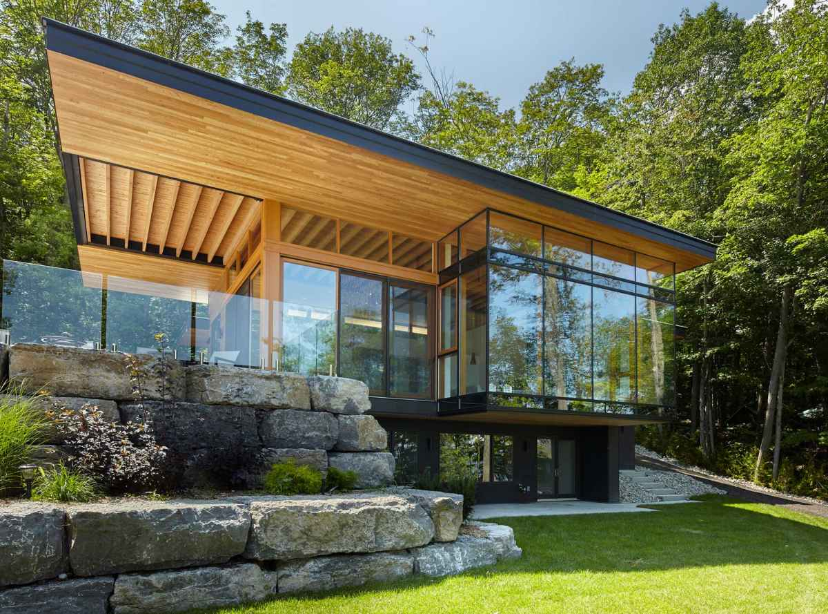 The main cottage has a beautiful stone terrace with glass railings which can function as a natural extension of the living area