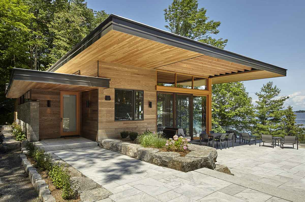 The entrance into the main cottage blends right in and has a simple and modest design