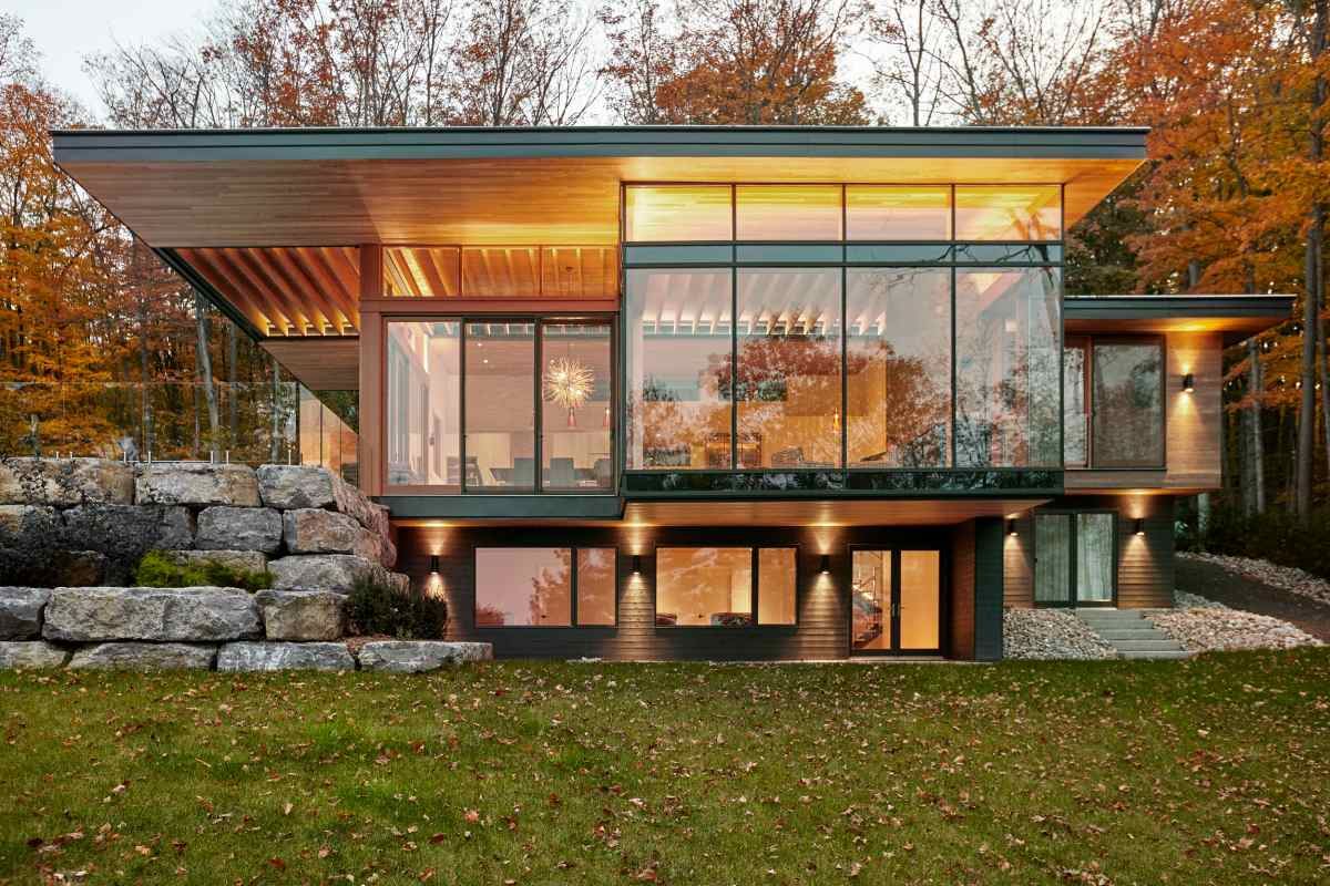 Large windows let the outdoors in and infuse the interior living areas with lots of natural light