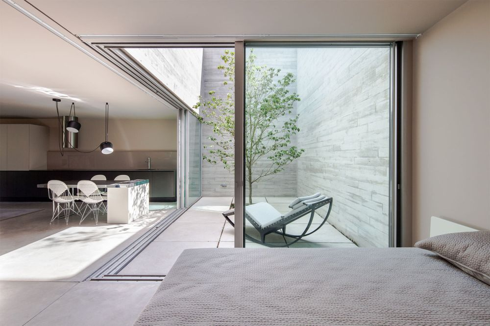 The shelter beneath the pool has a small interior courtyard