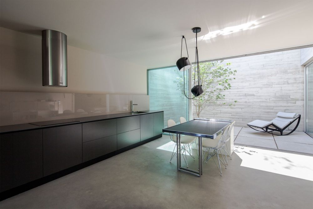 The kitchen takes up one of the walls and has a linear and open design