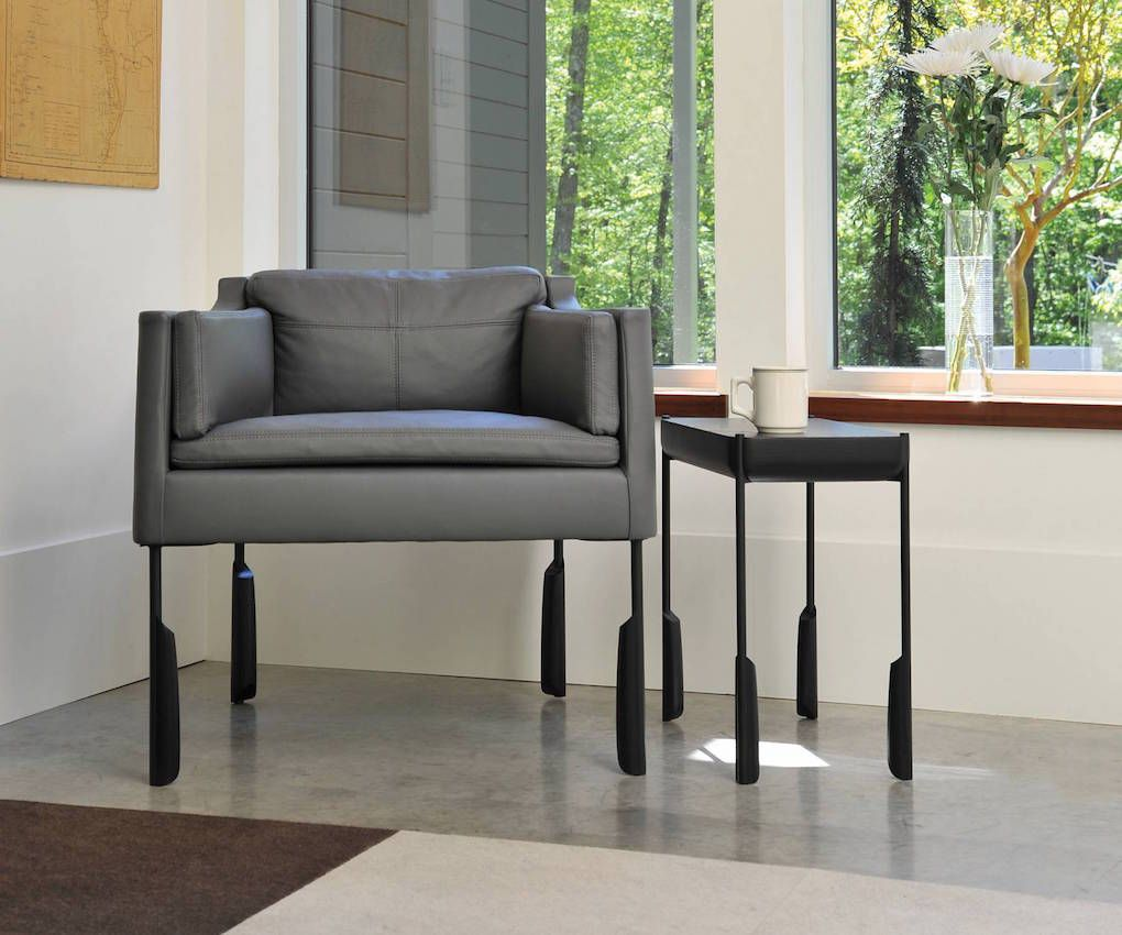 The Altai easy chair upholstered in napa leather, with the Altai cocktail table.