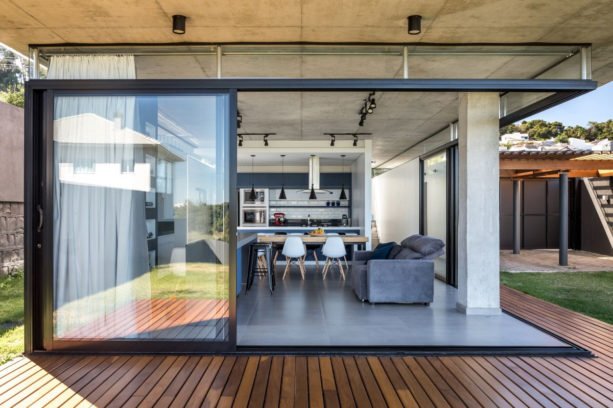The ground floor has an open floor plan which extends onto a wooden deck that wraps around it