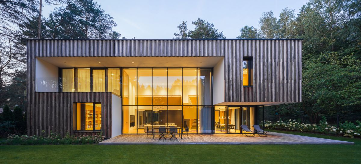 The exterior is clad in lots of thin strips of wood which reference the forest