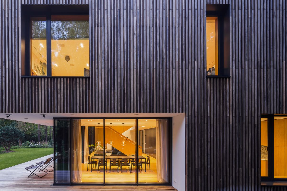 The deck extends along the side of the house and connects the social areas to the outdoors
