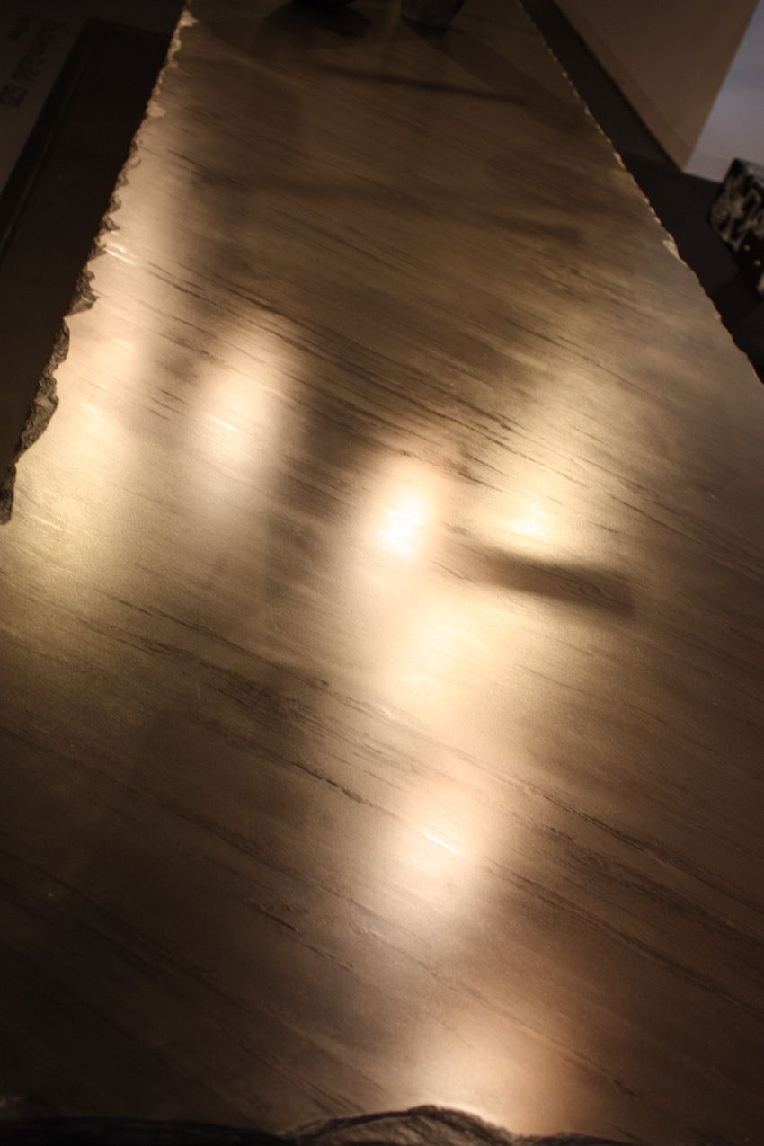 High shine means high interest in this case. Such a stunning slab table!