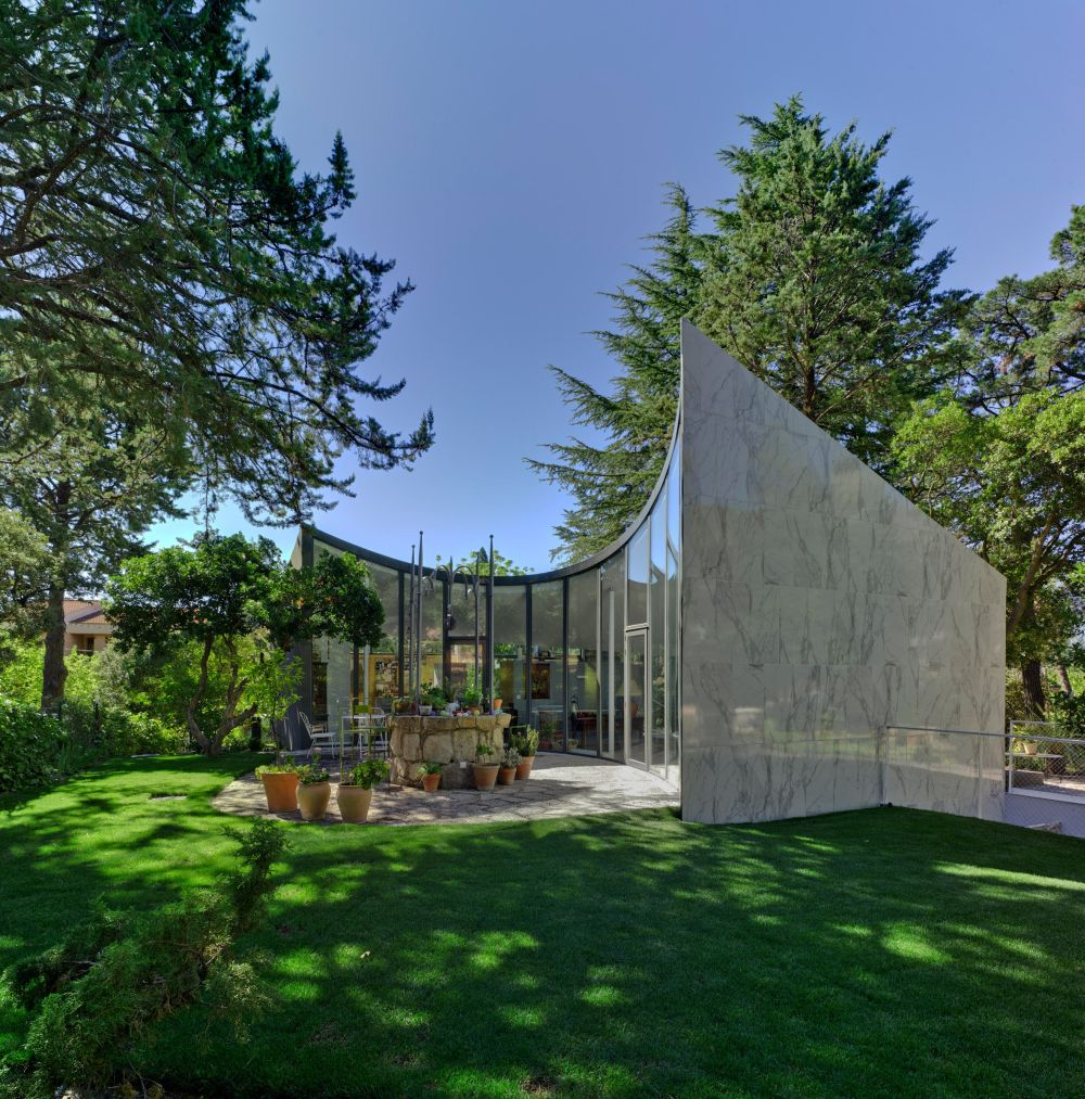 The overall architecture and shape of the house give it a futuristic appearance