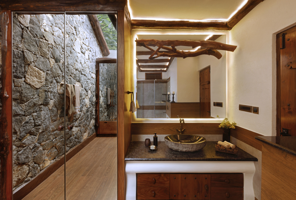 Stone accent walls help to bring the outdoors in and add a lot of character to the design