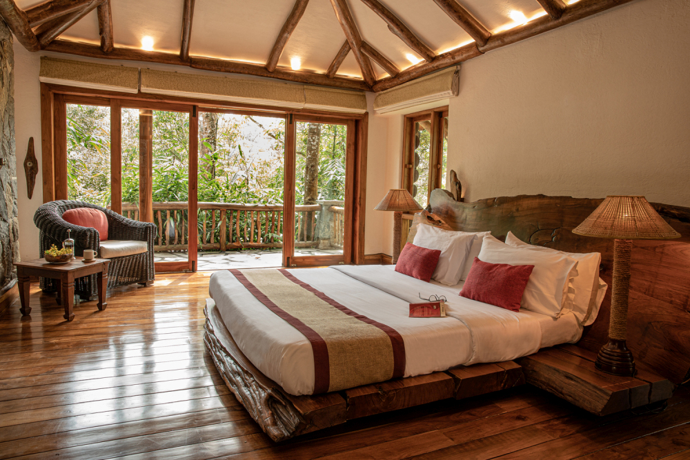 The master bedroom opens onto a private deck with a great view of the forest
