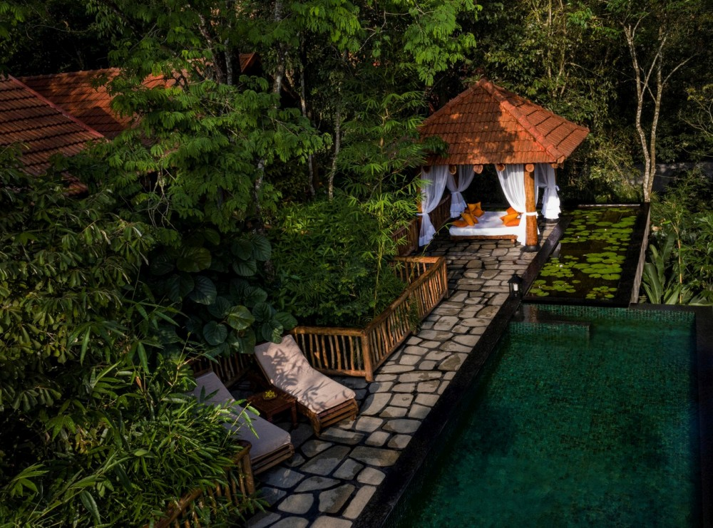 The infinity pool and the gazebo are framed by beautiful lily ponds