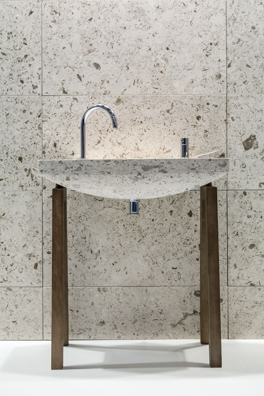 The sleek and spare look of the basin is enhanced with a minimal, rustic wood frame.