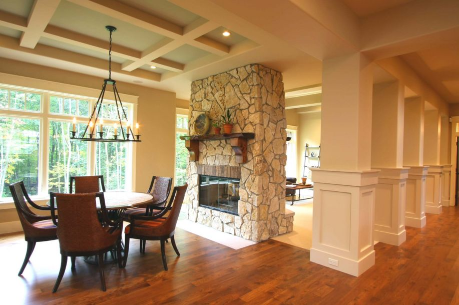 A stone fireplace is always eye-catching, more so if it has a central position