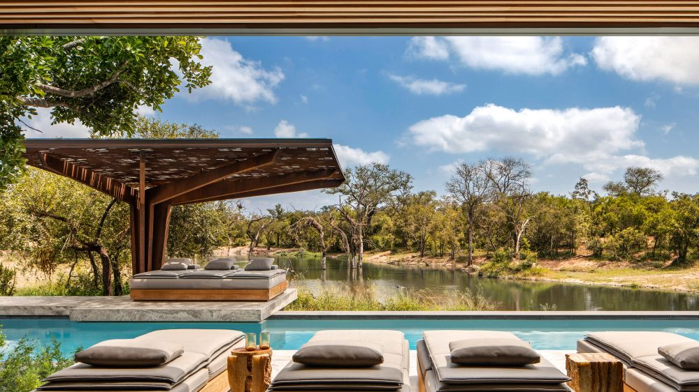 The pool areas include lounge decks and pavilions designed in a modern style