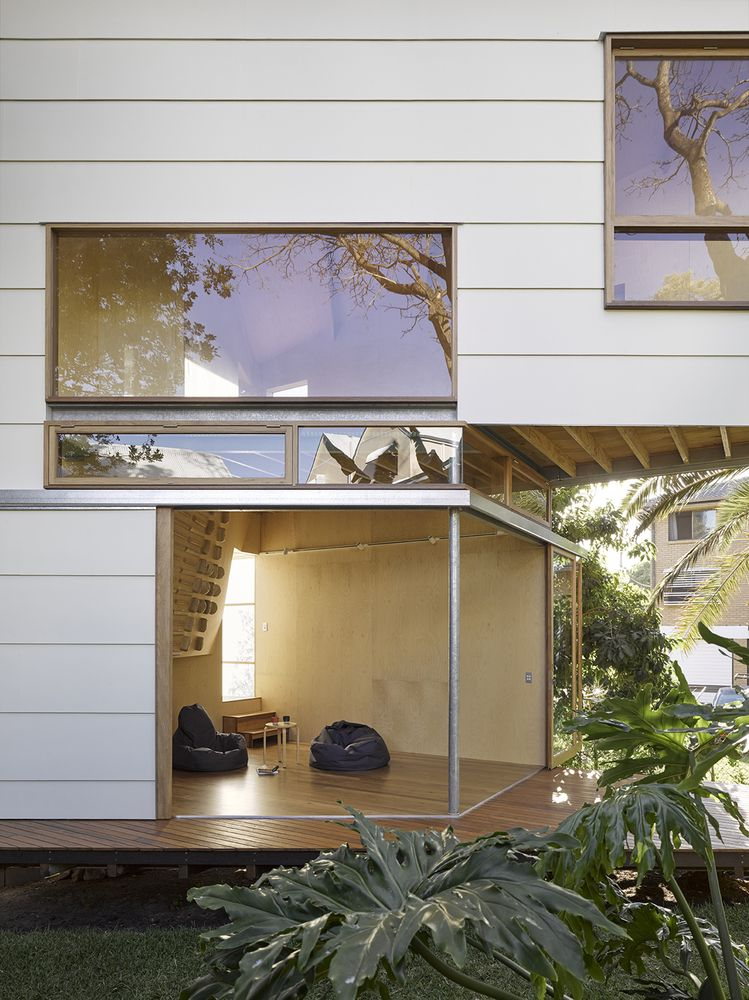 The ground floor spaces open to the garden and they're also linked to a wooden deck