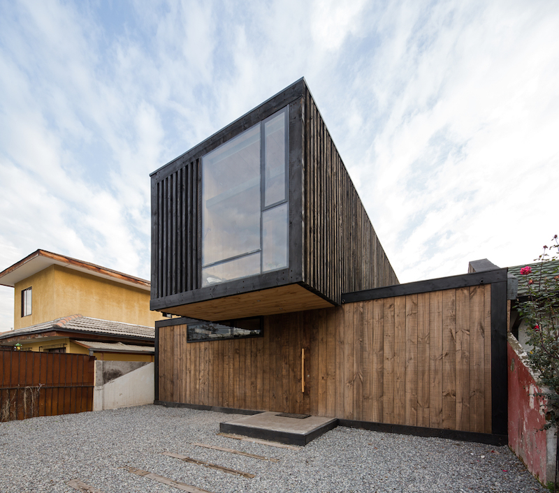 The front yard was expanded under the cantilevering section to make room for three cars