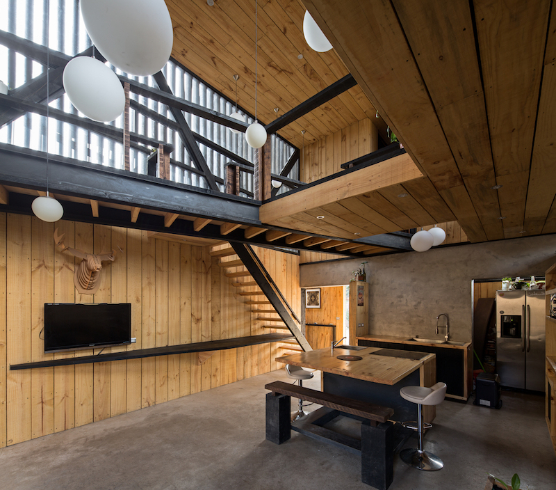 A set of stairs and bridges connect the spaces on the upper level and provide access downstairs