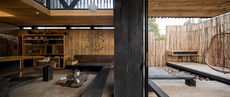 The rear of the property is occupied by a wooden deck structure which is seamlessly connected to the living area