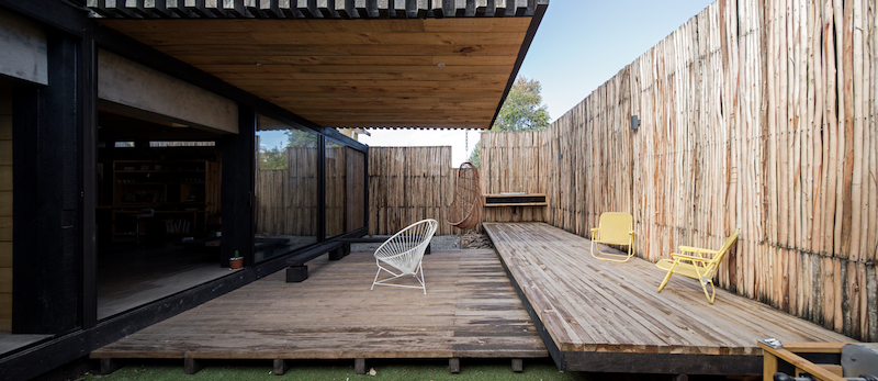 The tall wooden fences frame the backyard and give it a nice intimate feel