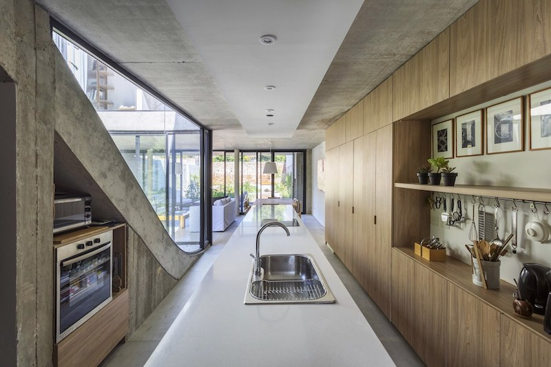 The interior decor is simple and centered around pure and basic materials