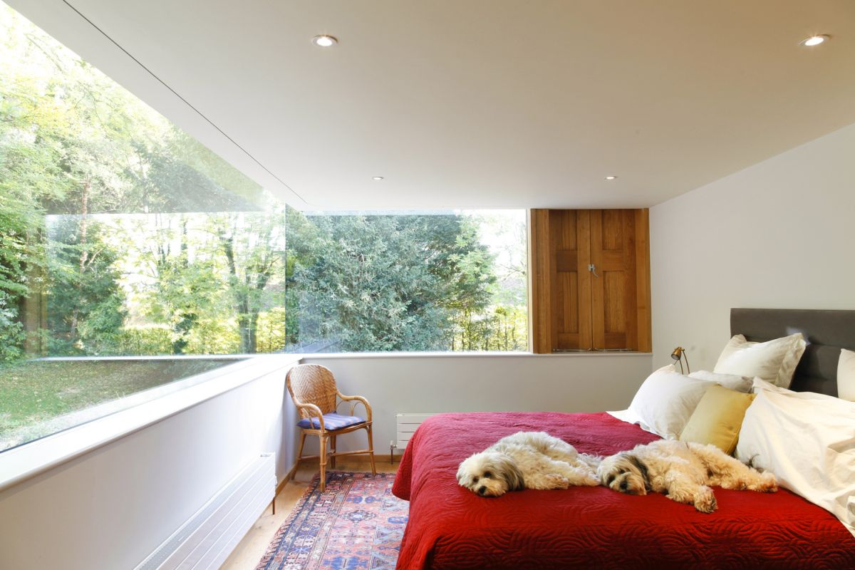 The bed placement takes maximum advantage of the windows.
