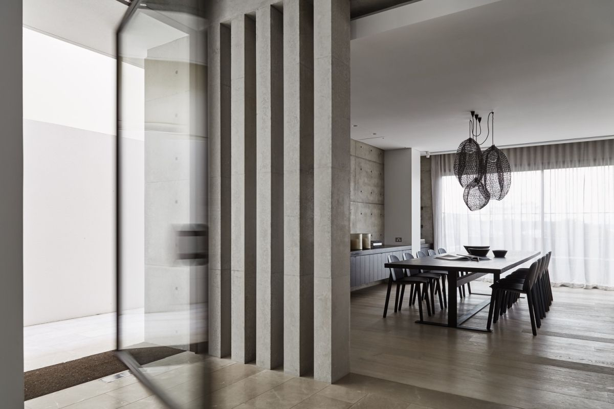 The concrete pillars go with the modern feel of the space.