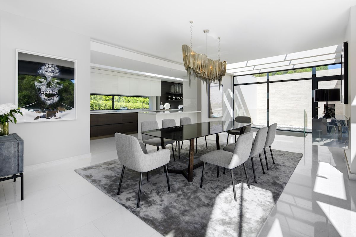 The kitchen and the dining area are connected but they each maintain their individuality