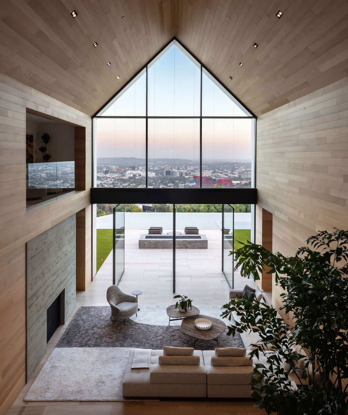 The interior spaces are simple and have little furniture which puts an emphasis on the outdoors and the panoramic views