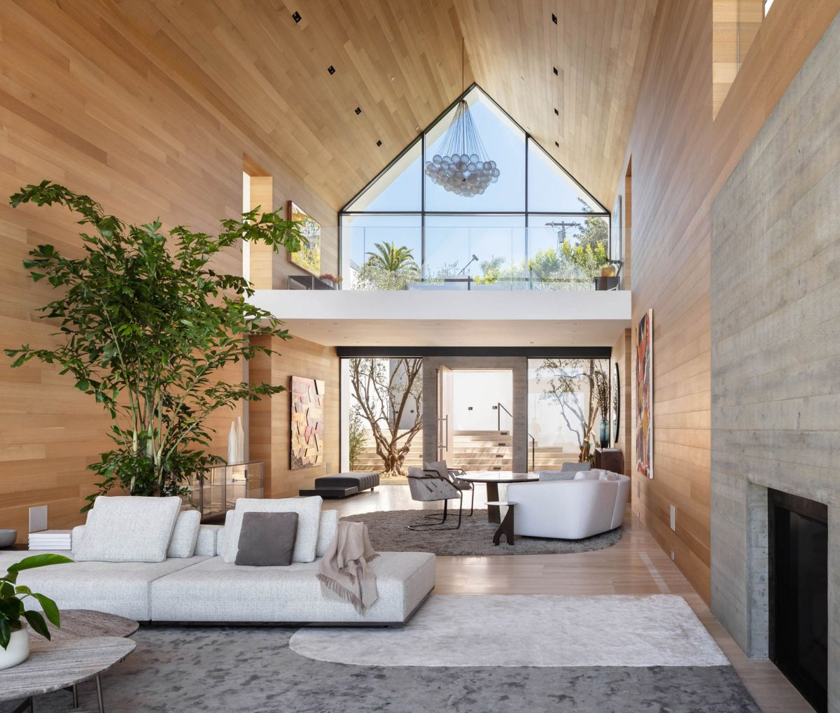 The living room has 30 ft (9m) high ceiling and that gives it a very open and airy look