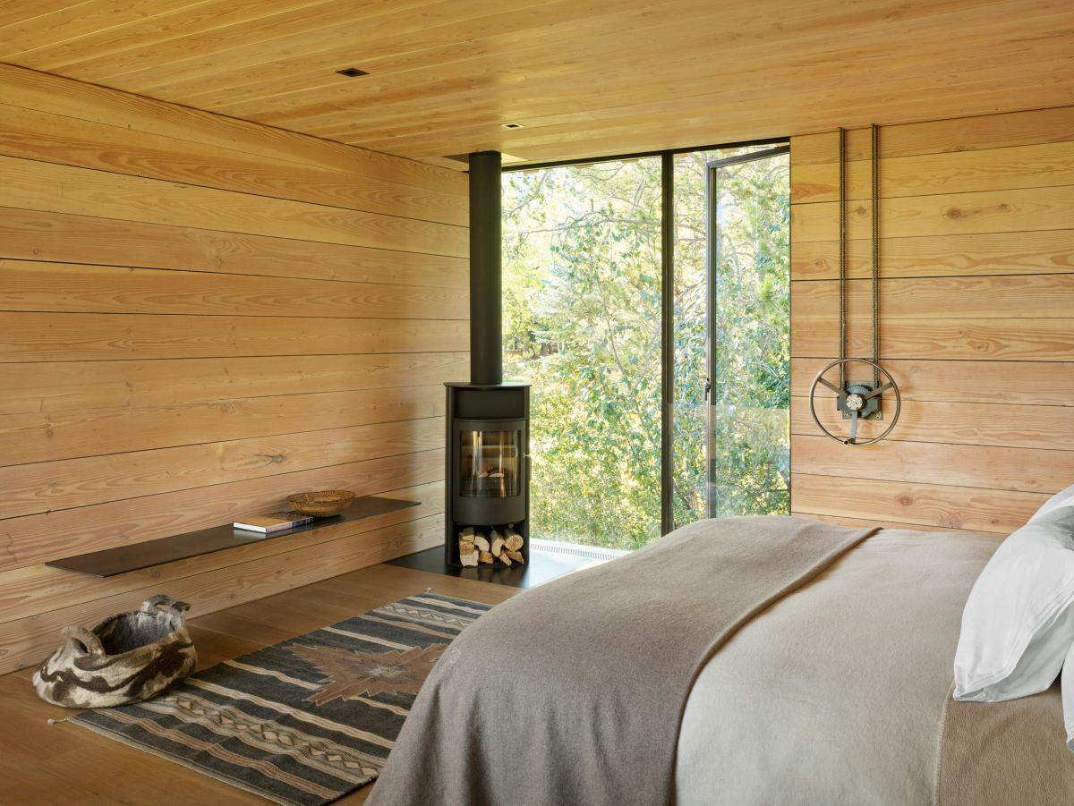 The upstairs master suite has its own little fireplace in the corner
