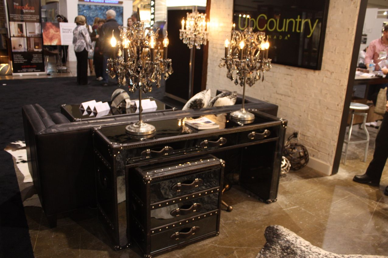 A mirrored surface can reflect the light of a chandelier or of a table lamp for added glamour
